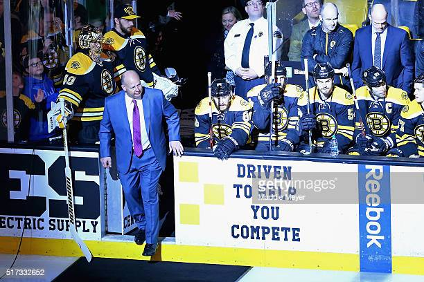 Claude Julien of the Boston Bruins enters the ice to be honored as the coach with the most wins in franchise history with 388 before the game against...