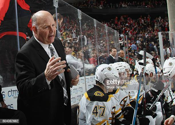 Claude Julien of the Boston Bruins instructs his team during the second period against the New Jersey Devils at the Prudential Center on January 8...