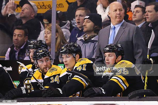 Claude Julien of the Boston Bruins looks on from his bench during the third period against the San Jose Sharks at TD Garden on November 17 2015 in...