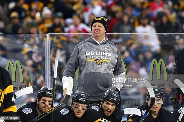 Claude Julien of the Boston Bruins looks on with his team from the bench in the second period against the Montreal Canadiens during the 2016...