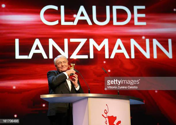 Claude Lanzmann smiles onstage with the Golden Honorary Bear Award during the 63rd Berlinale International Film Festival at Berlinale Palast on...