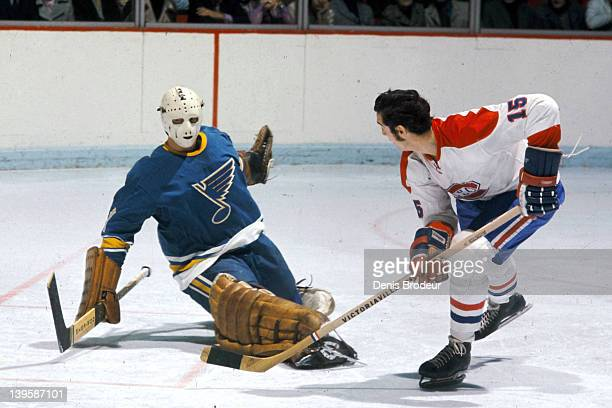 Claude Larose of the Montreal Canadiens scores on a backhand shot during a game against the St louis Blues Circa 1960 at the Montreal Forum in...