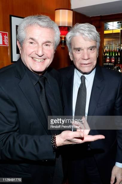 Claude Lelouch and Bernard Tapie attend Claude Lelouch receives the Insignia of Officer of the Legion of Honor at Club 13 on February 13 2019 in...