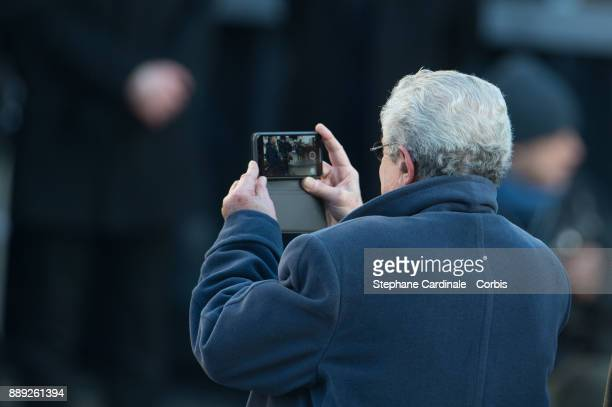 Claude Lelouch is seen filming with an Iphone during Johnny Hallyday's Funeral at Eglise De La Madeleine on December 9 2017 in Paris France France...