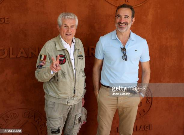 Claude Lelouch, Jean Dujardin attend the Men's Singles Final during day 15 of the 2021 Roland-Garros, French Open, a Grand Slam tennis tournament at...