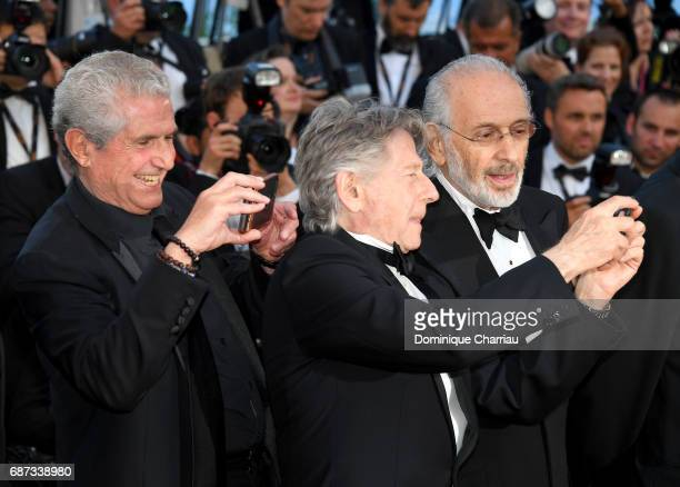 Claude Lelouch Roman Polanski and Jerry Schatzberg attend the 70th Anniversary screening during the 70th annual Cannes Film Festival at Palais des...