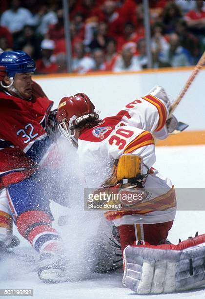 Claude Lemieux of the Montreal Canadiens collides with goalie Mike Vernon of the Calgary Flames during the 1989 Stanley Cup Finals in May 1989 at the...