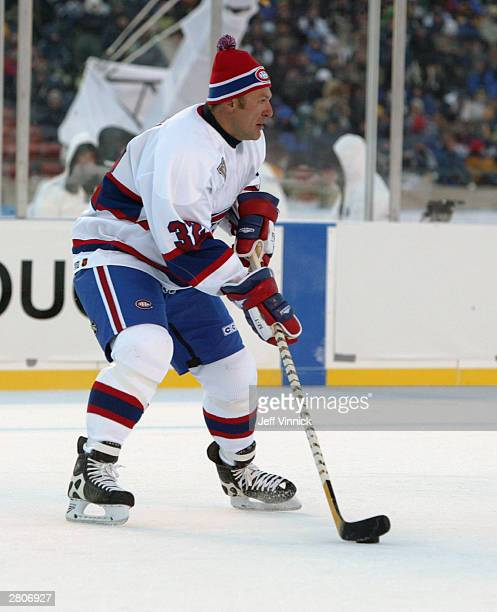 Claude Lemieux of the Montreal Canadiens looks to make a play against the Edmonton Oilers during the Molson Canadien Heritage Classic Megastars Game...