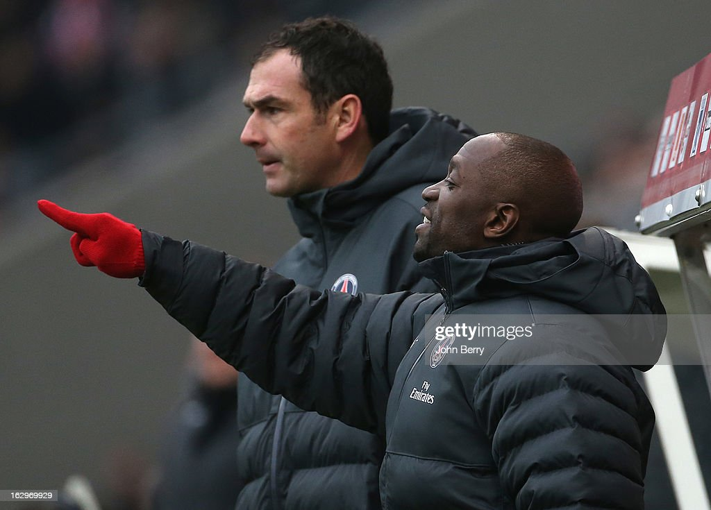 Claude Makelele and Paul Clement, assistant-coaches of PSG look on during the french Ligue 1 match between Stade de Reims Champagne FC and Paris Saint-Germain FC at the Stade Auguste Delaune on March 2, 2013 in Reims, France.