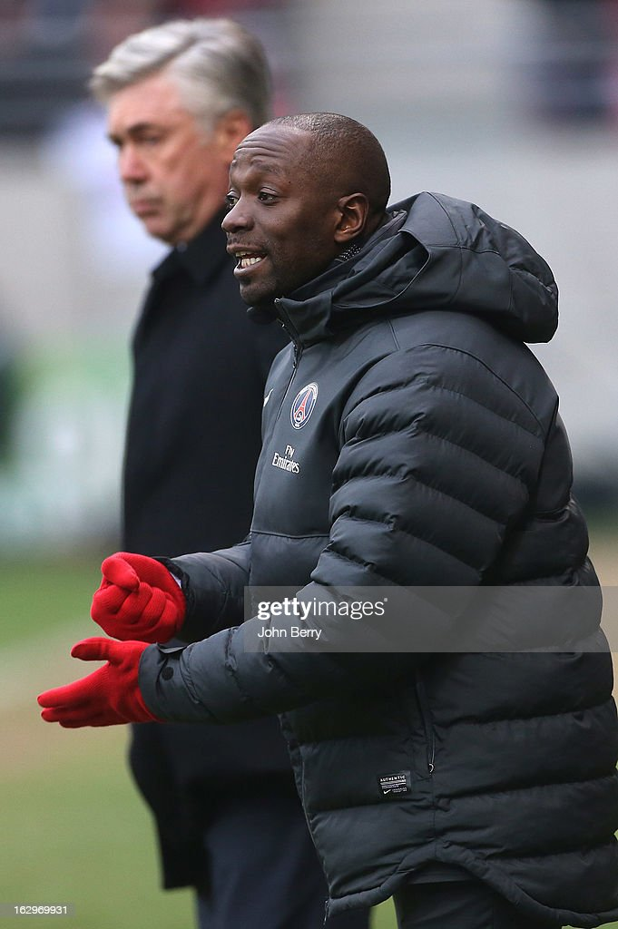 Claude Makelele, assistant-coach and Carlo Ancelotti, coach of PSG look on during the french Ligue 1 match between Stade de Reims Champagne FC and Paris Saint-Germain FC at the Stade Auguste Delaune on March 2, 2013 in Reims, France.