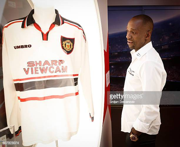 Claude Makelele looks at the Manchester United jersey in the UEFA Trophy Tour truck during the UEFA Champions League Trophy Tour presented by...