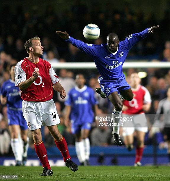 Claude Makelele of Chelsea attemps to get the ball as Dennis Bergkamp of Arsenal looks on during the Premiership match at Stamford Bridge in London...