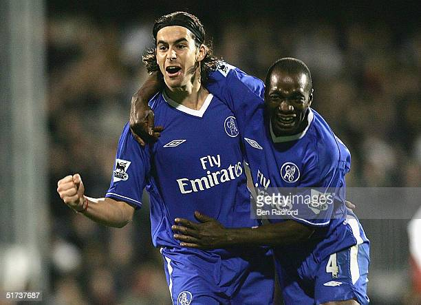 Claude Makelele of Chelsea helps Tiago celebrate his goal during the Barclays Premiership match between Fulham and Chelsea on November 13 2004 at...