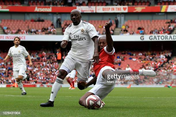 Claude Makelele of Real Madrid in action with Luis Boa Morte of Arsenal during the match between Arsenal Legends and Real Madrid Legends at Emirates...