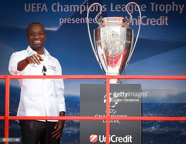 Claude Makelele smiles near the trophy on the UEFA Trophy Tour truck during the Champions League Trophy Tour by UniCredit at Atheneum Square on...