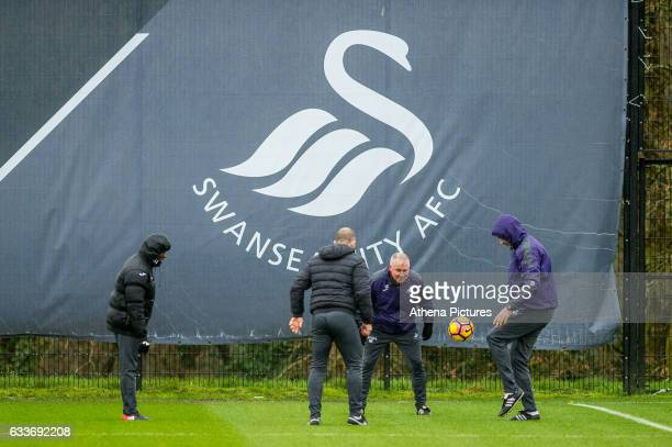 Claude Makelele Swansea Fitness coach Karl Halabi Swansea City Assistant manager Nigel Gibbs and Manager Paul Clement play football during the...