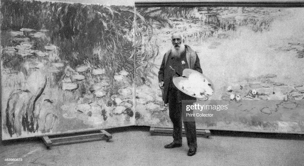 Claude Monet, French Impressionist painter, 1923. Monet (1840-1926) in front of one of the vast canvases of the waterlilies in his garden at Giverny that he painted in the last years of his life. A photograph from Album de Photographies, Dans L'Intimite de Personnages Illustres, 1855-1915, Editions MD, 22 Rue de L'Arcade, Paris 8, 1855-1915.