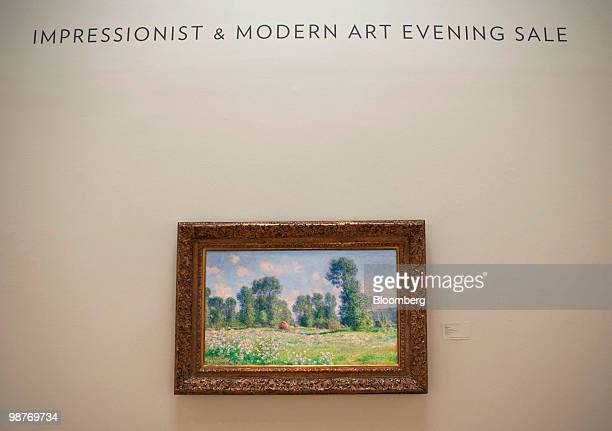 Claude Monet's 'Effet de Printemps a Giverny' hangs on display during a press preview at Sotheby's in New York US on Friday April 30 2010 The piece...