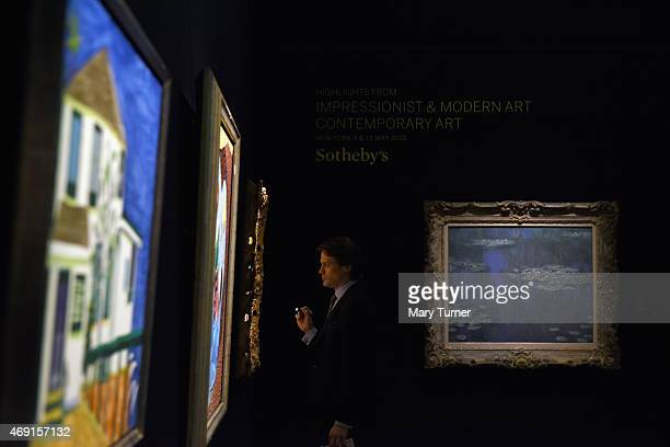 Claude Monet's ' Nympheas' from 1905 which has not been seen in public since 1945 hangs in a gallery as a specialist examines works on show at...