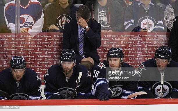Claude Noel head coach of the Winnipeg Jets adjusts his glasses in third period action of an NHL game against the Anaheim Ducks at the MTS Centre on...