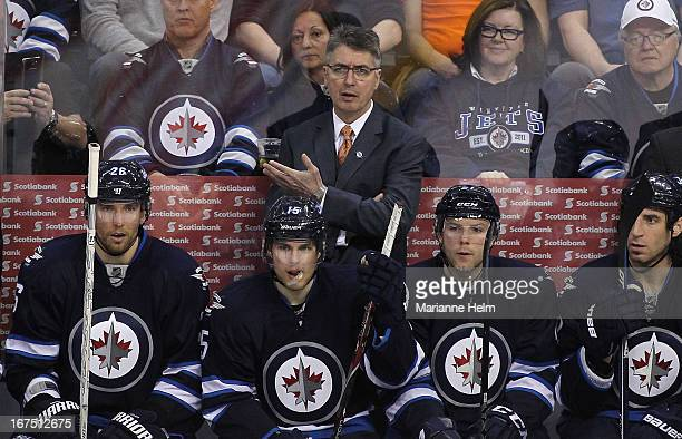 Claude Noel head coach of the Winnipeg Jets gestures from the bench during a game against the Montreal Canadiens during third period NHL action on...