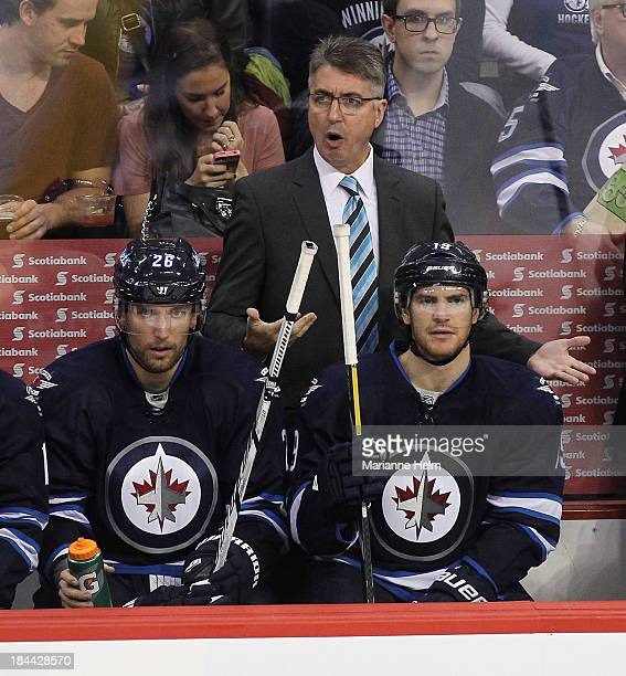 Claude Noel head coach of the Winnipeg Jets gestures from the bench in third period action of an NHL game against the New Jersey Devils at the MTS...