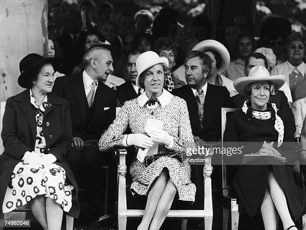 Claude Pompidou the wife of French President Georges Pompidou watches the Bastille Day procession on the Champs Elysees 14th July 1973 On the left is...