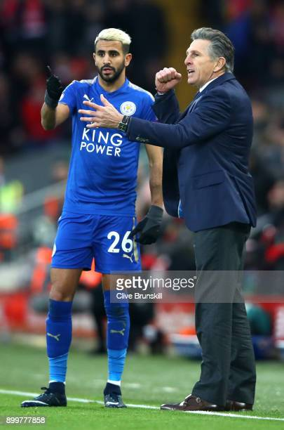 Claude Puel Manager of Leicester City gives Riyad Mahrez of Leicester City instructions during the Premier League match between Liverpool and...