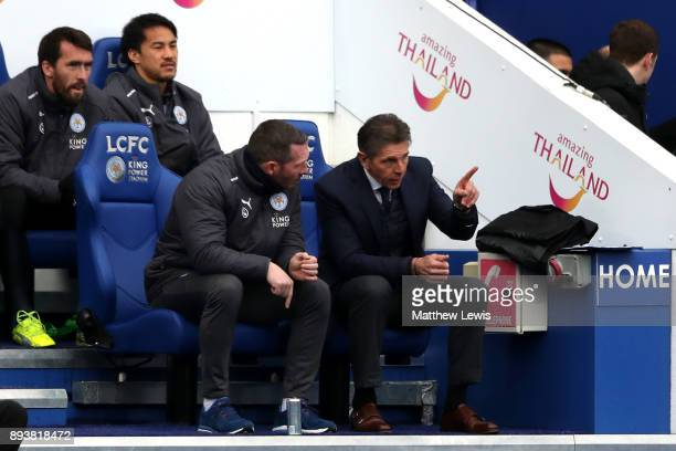 Claude Puel Manager of Leicester City speaks to Michael Appleton Leicester City assistant manager during the Premier League match between Leicester...