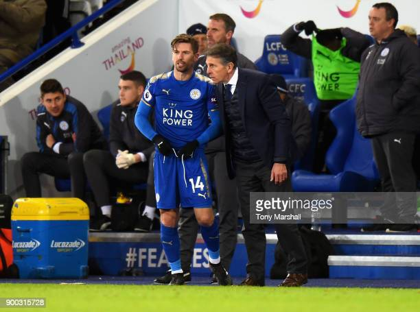 Claude Puel Manager of Leicester City talks to Adrien Silva of Leicester City as he makes his debut of Leicester City during the Premier League match...