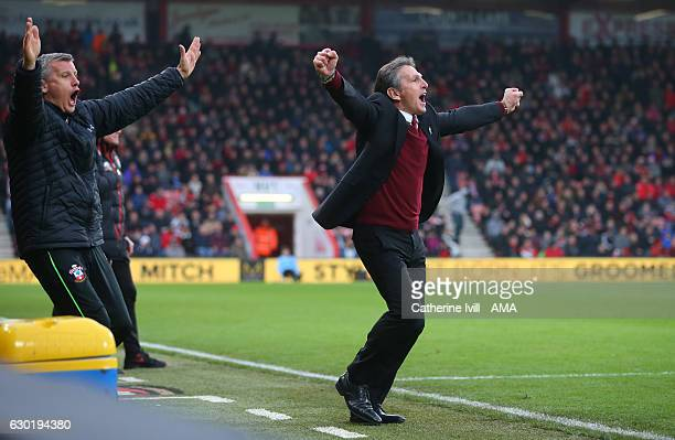 Claude Puel manager of Southampton celebrates after Jay Rodriguez of Southampton scores a goal to make it 13 during the Premier League match between...