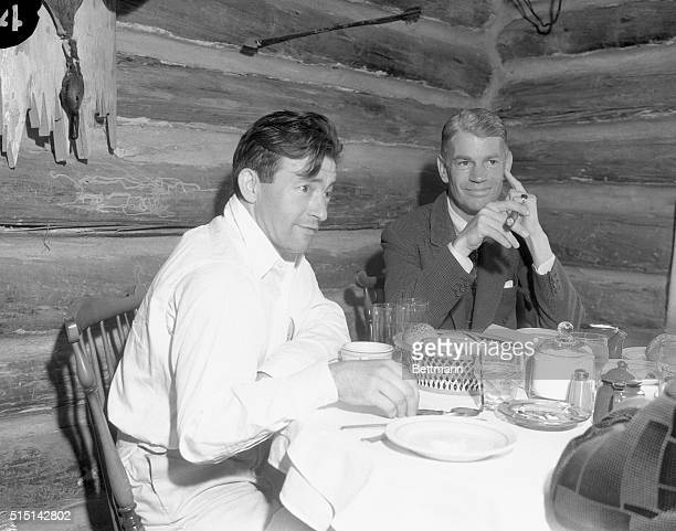 Claude Rains English actor playing the title role in The Invisible Man and James Whale director of the picture shown having their lunch in the...