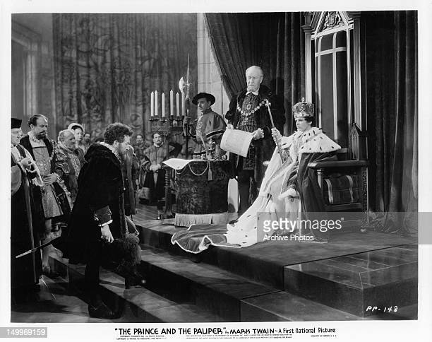 Claude Rains stepping up to the thrown of Robert J Mauch in a scene from the film 'The Prince And The Pauper' 1937