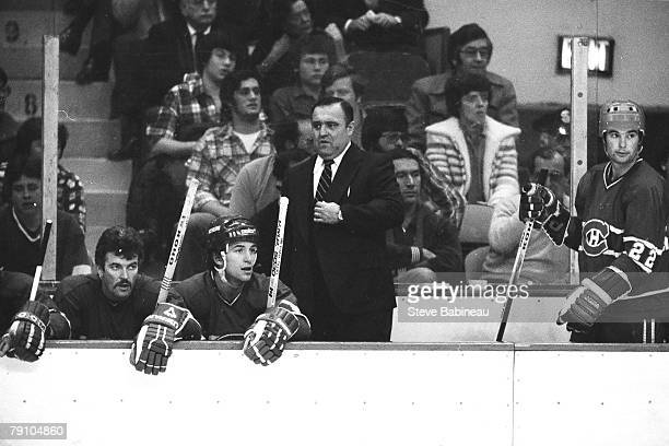 Claude Ruel head coach of the Montreal canadiens directs team from behind bench
