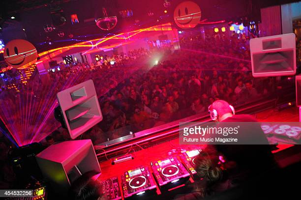 Claude VonStroke performs in front of club goers at Space nightclub Ibiza July 17 2011