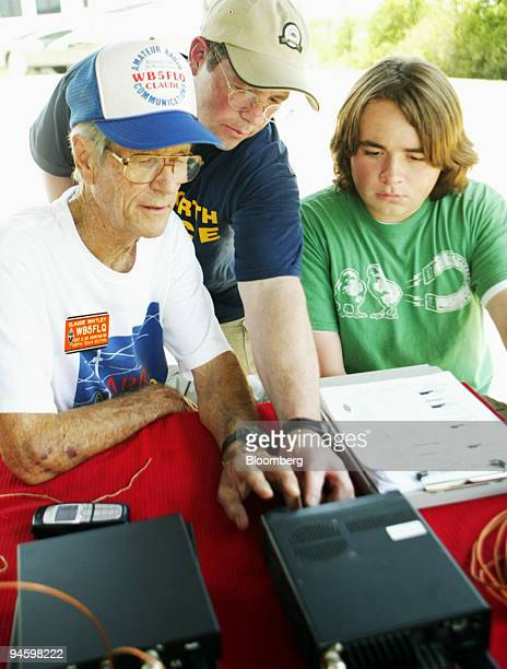 Claude Whitley left to right Jim Byford and Christopher Byford set up a ham radio during The National Association for Amateur Radio Field Day in...