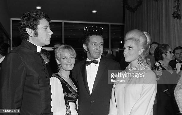 """Claude Wolff and his wife Petula Clark: and Mr. And Mrs. Arthur P. Jacobs, producer, at the West coast premier of """"Goodbye, Mr. Chips."""""""