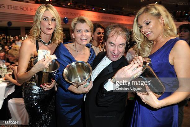 Claudelle Deckert, Andrea Spatzek, Chris de Burgh and Magdalena Brzeska attend UNESCO Charity Gala 2011 at Maritim Hotel on November 19, 2011 in...