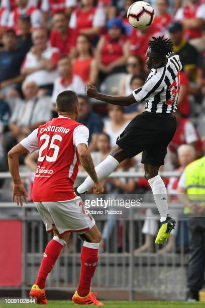 Claudemir of SC Braga competes for the ball with Christian Atsu of Newcastle during the Preseason friendly between SC Braga and Newcastle on August 1...