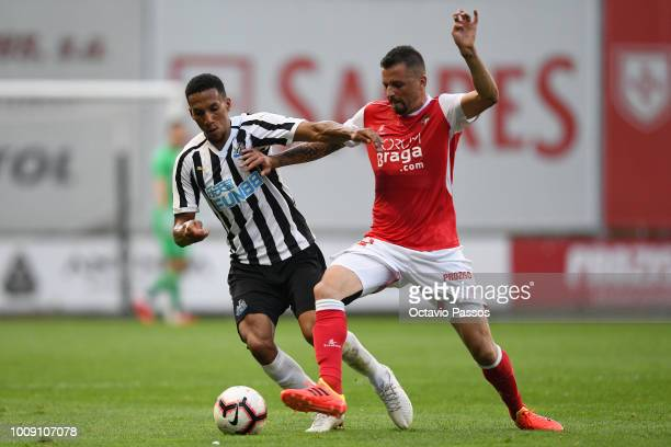 Claudemir of SC Braga competes for the ball with Isaac Hayden of Newcastle during the Preseason friendly between SC Braga and Newcastle on August 1...