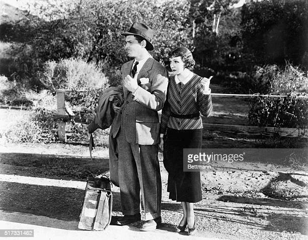 Claudette Colbert and Clark Gable hitchhiking in a scene from It Happened One Night Movie still