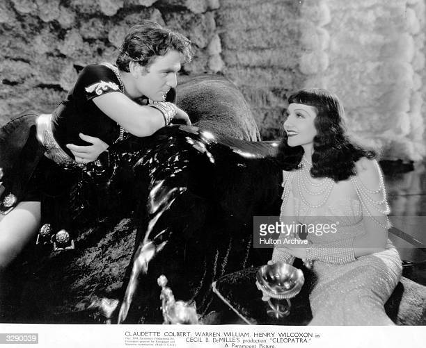 Claudette Colbert , as she appears in the title role of Cecil B DeMille's 'Cleopatra' with Henry Wilcoxon as Marc Antony.