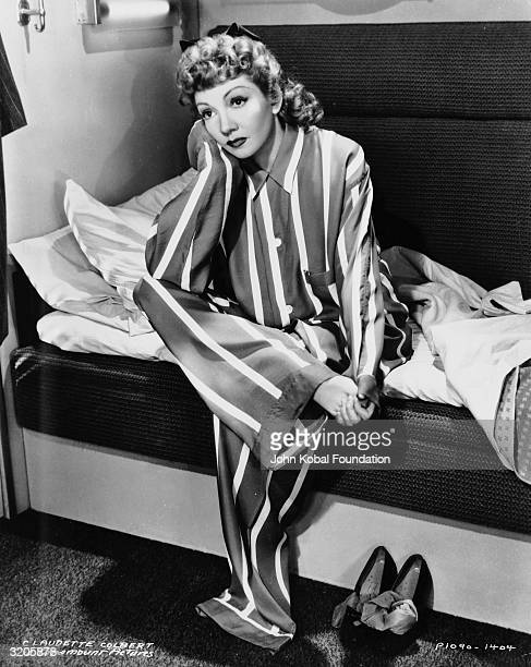 Claudette Colbert ponders her situation whilst wearing pyjamas in Preston Sturges' screwball comedy film 'The Palm Beach Story'