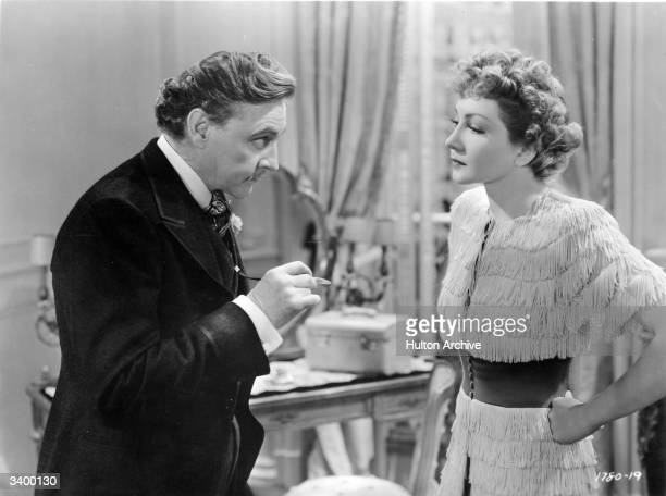 Claudette Colbert with John Barrymore in a scene from the film 'Midnight' directed by Mitchell Leisen for Paramount