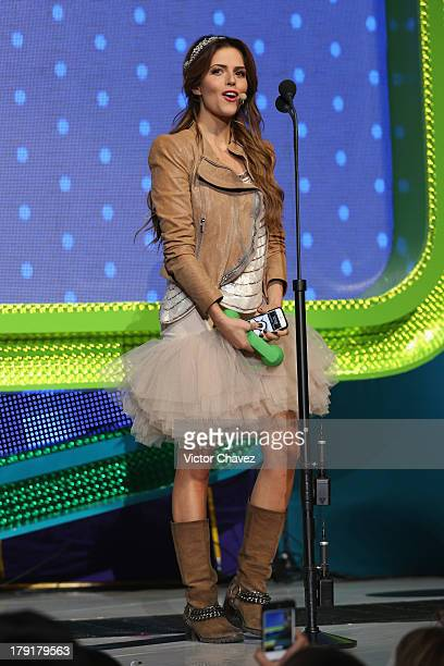 Claudia Alvarez speaks onstage during the Kids Choice Awards Mexico 2013 at Pepsi Center WTC on August 31 2013 in Mexico City Mexico
