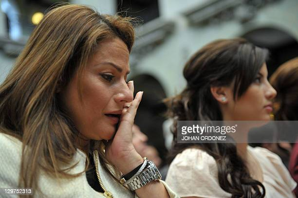 Claudia Arbenz Canales granddaughter of former president Jacobo Arbenz cries on October 20 during a ceremony at the Culture Palace in Guatemala City...