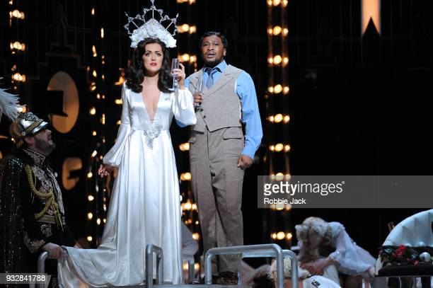 Claudia Boyle as Violetta Valery and Lukhanyo Moyake as Alfredo Germont with artists of the company in English National Opera's production of...