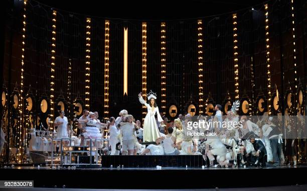 Claudia Boyle as Violetta Valery with artists of the company in English National Opera's production of Giuseppe Verdi's La traviata directed by...
