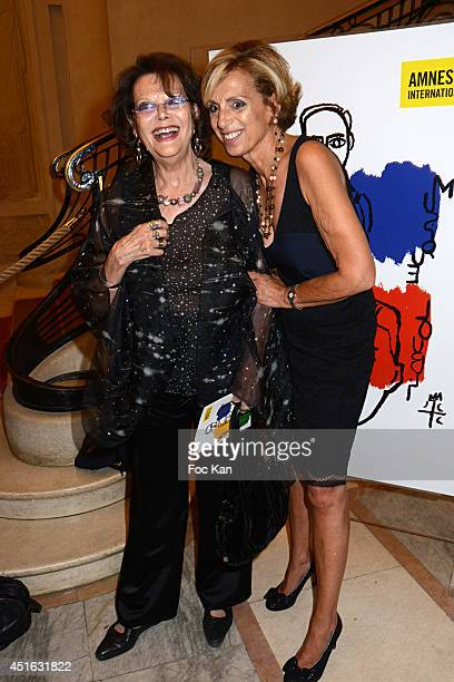 Claudia Cardinale and Genevieve Garrigos attend the '20th Amnesty International France' Gala At Theatre Des champs Elysees on July 2 2014 in Paris...