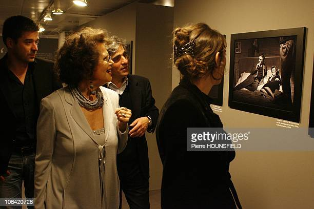Claudia Cardinale and her daughter Claudia Squitieri Ronald Chammah Curator of the Exhibition 'Divas Italia' in Paris France on May 05 2009